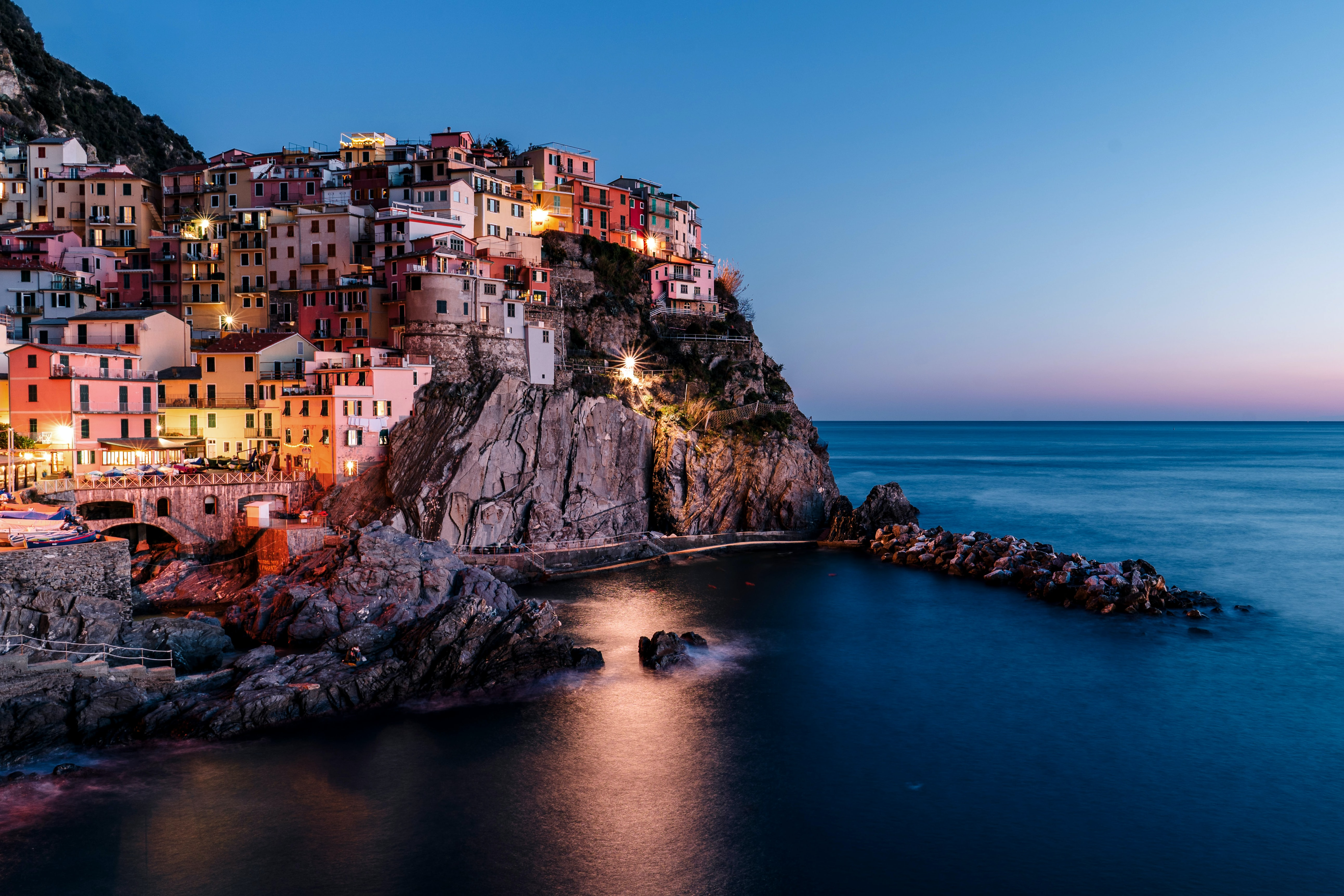 A colorful city on the coast of Italy in the evening