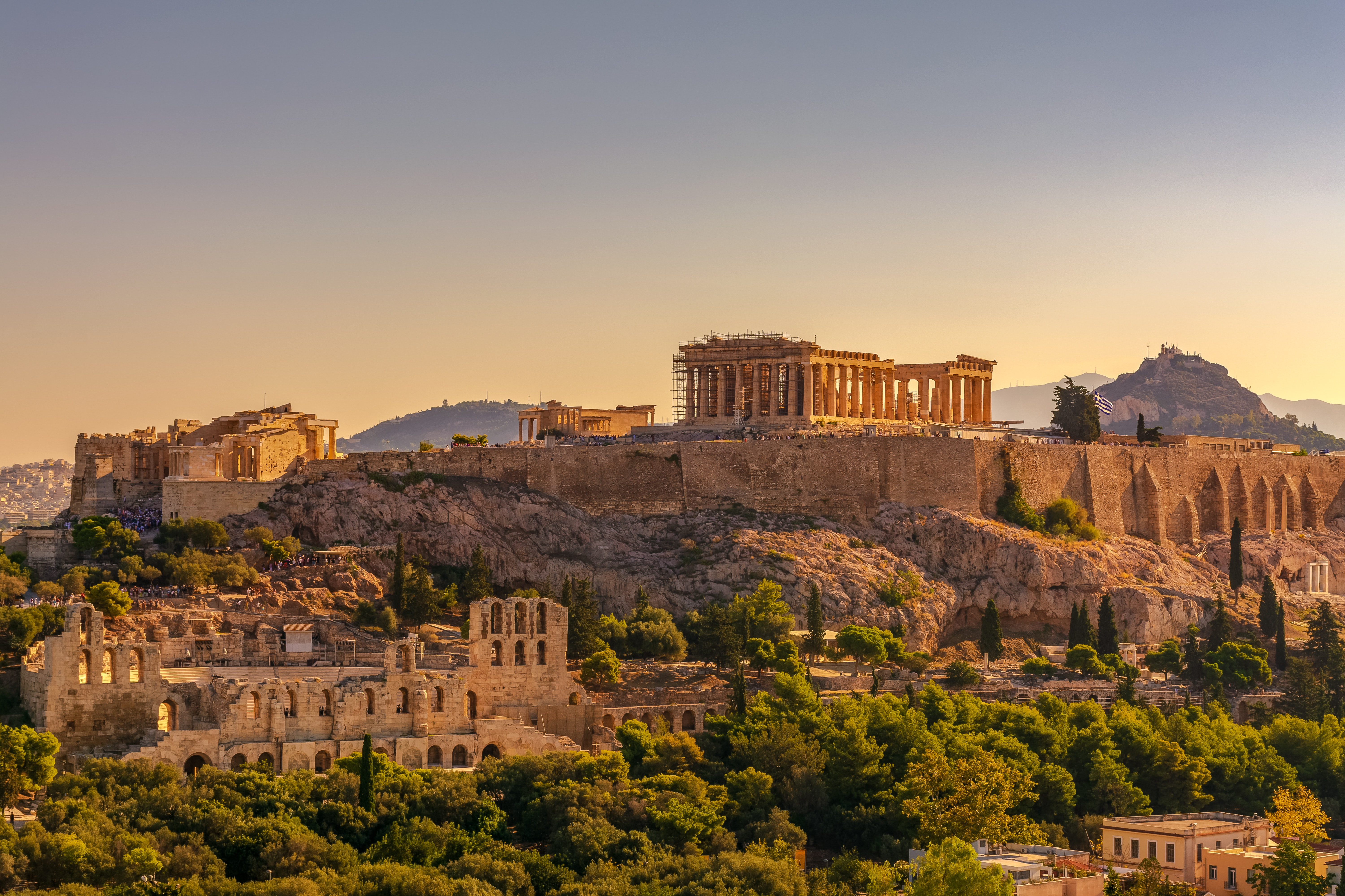 The ancient Acropolis on top of a hill in Athens at sunrise