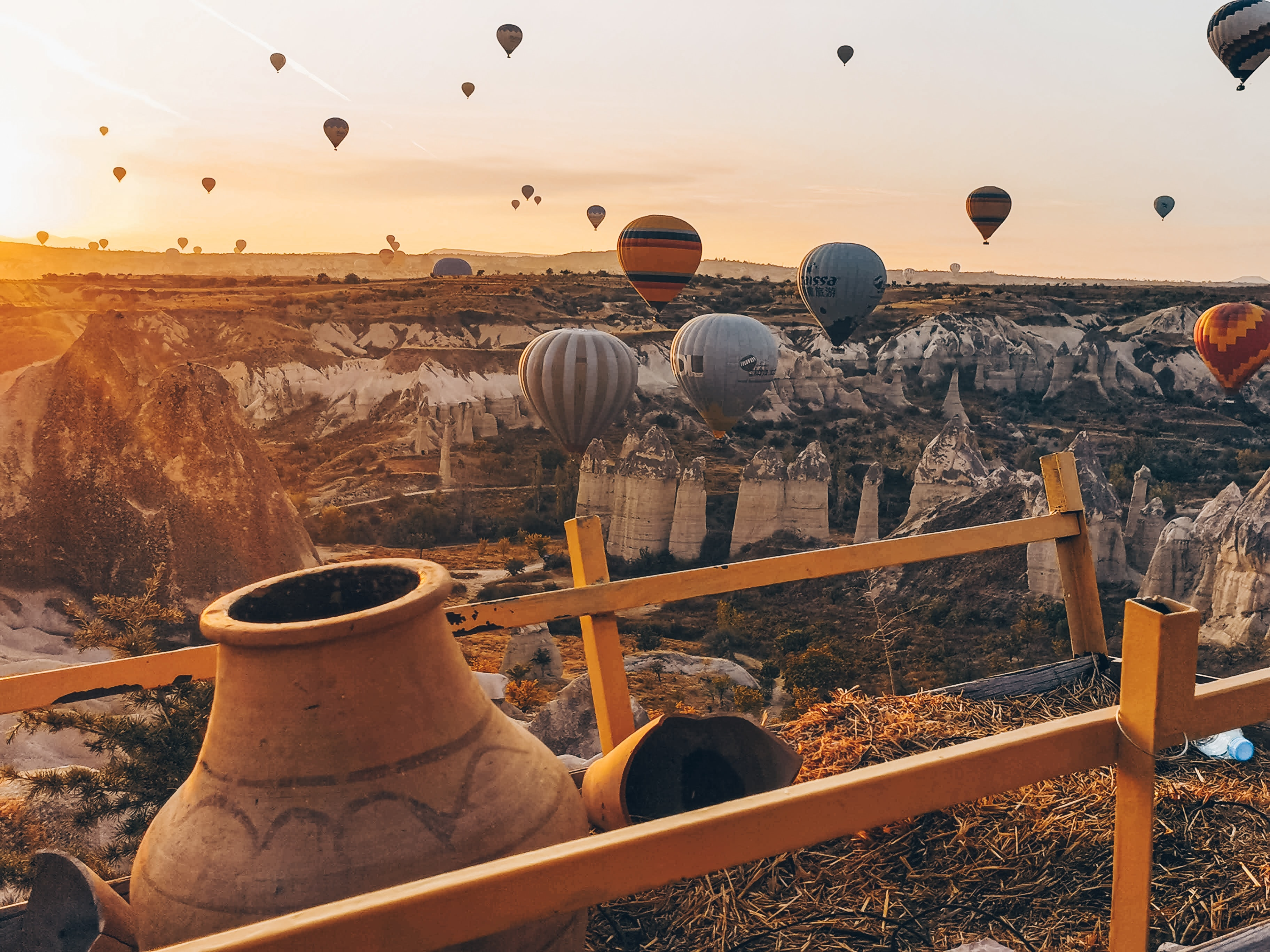 Hot air balloons in the rocky landscapes of Cappadocia in the morning